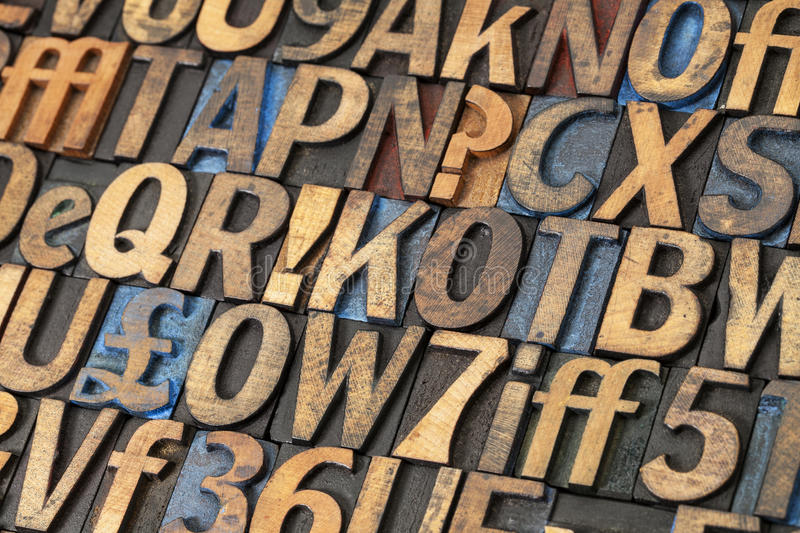 Vintage lettepress wood type. Alphabet abstract - vintage letterpress wood type printing blocks stained by black, blue and red ink stock images
