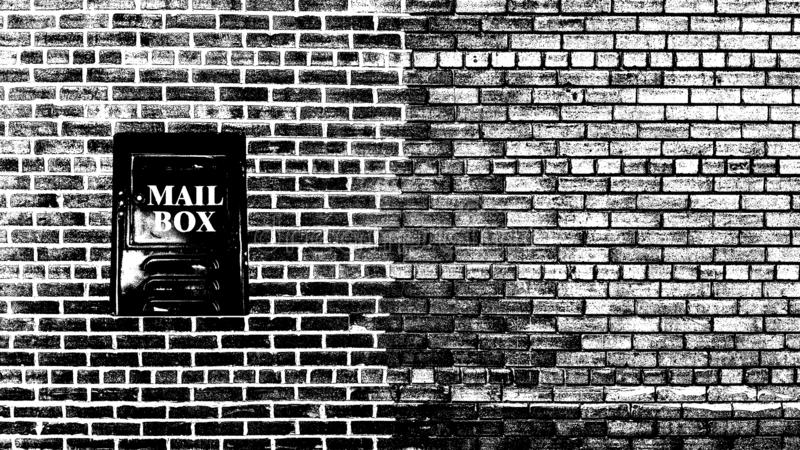 Vintage letterbox on grunge wall royalty free stock photo