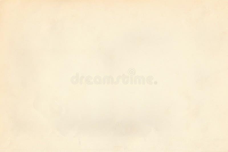 Vintage light beige old paper parchment textured background stock image