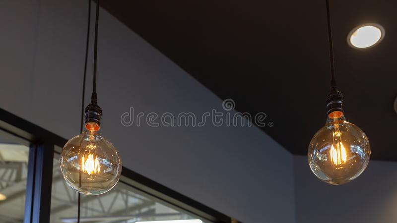 Vintage Light Blub in the coffee shop stock images