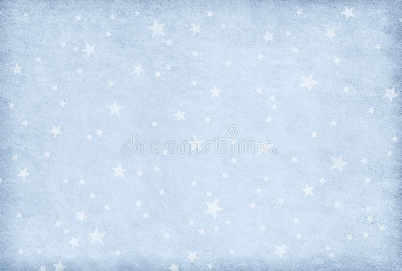 Vintage light blue paper decorated with stars stock image