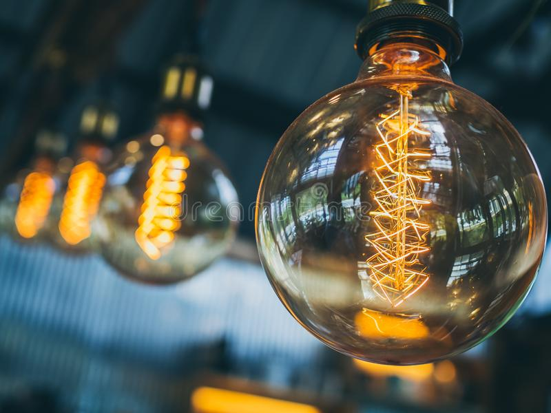 Vintage light bulbs in cafe. Decorative antique edison vintage style light bulbs on cafe background with copy space stock photos