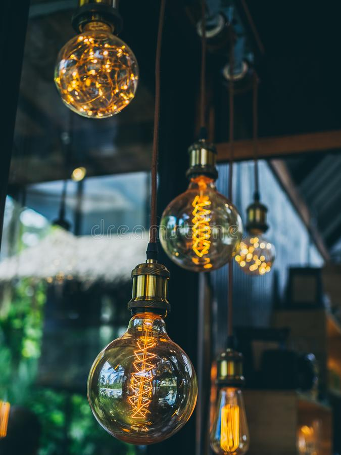 Vintage light bulbs in cafe. Decorative antique edison vintage style light bulbs on cafe background vertical style royalty free stock photos