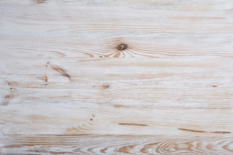 Vintage light wooden background. Natural wood with knots and well visible structure. Textured surface stock images