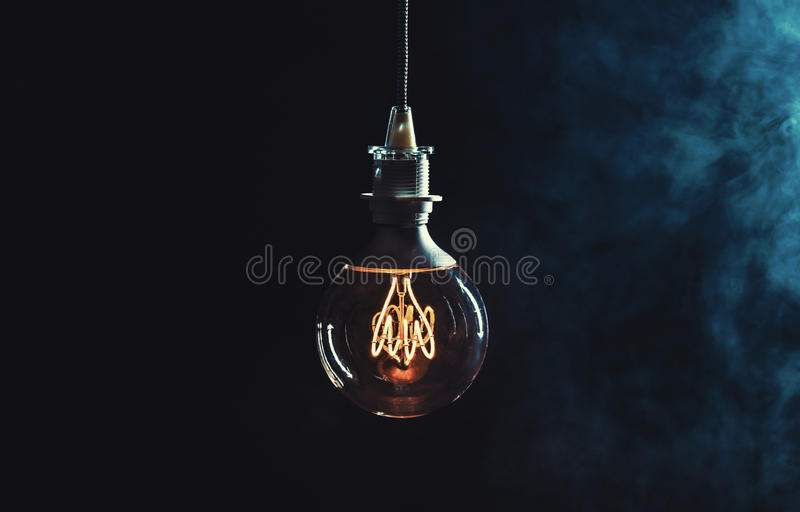 Vintage lightbulb on dark background stock photos