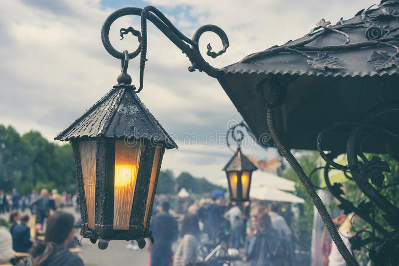 Vintage Lights at the Summer Fair. Vintage lanterns with yellow lamps at the summer fair in the city at the solstice Ligo in Riga royalty free stock images