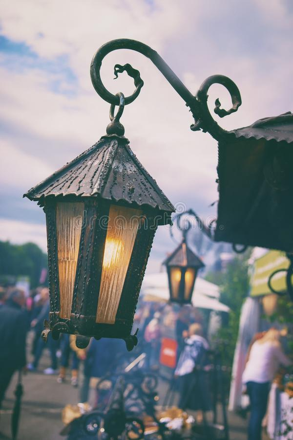 Vintage Lights at the Summer Fair. Vintage lanterns with yellow lamps at the summer fair in the city at the solstice Ligo in Riga royalty free stock photos
