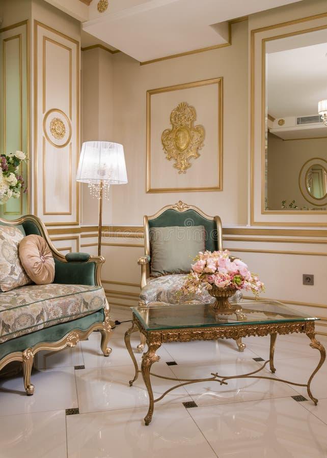 Vintage living room with fretwork. Vintage living room with golden fretwork royalty free stock photography