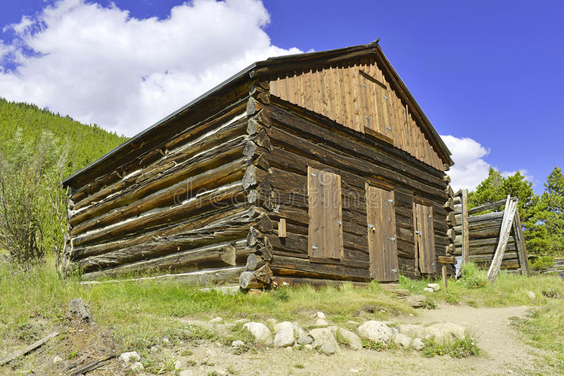 Vintage log cabin in old mining town in the mounta stock photos