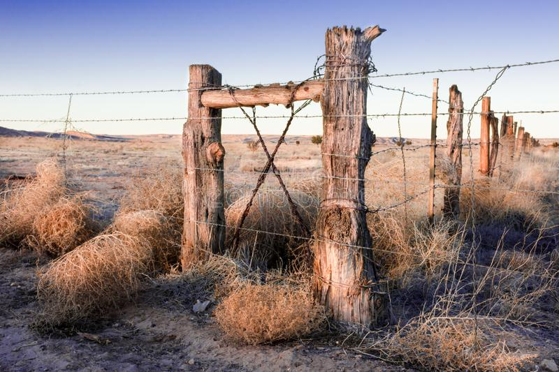 Vintage log fence on old Route 66 in New Mexico at sunset. royalty free stock images