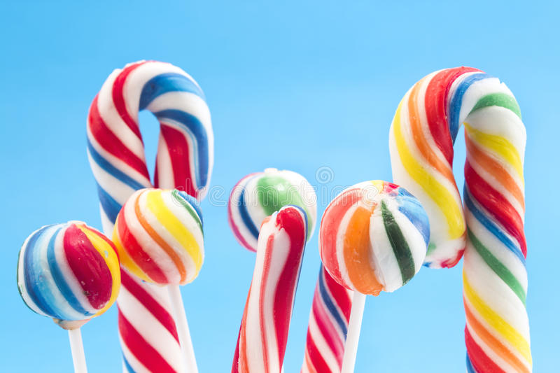 Vintage lollipops on a blue background stock photography
