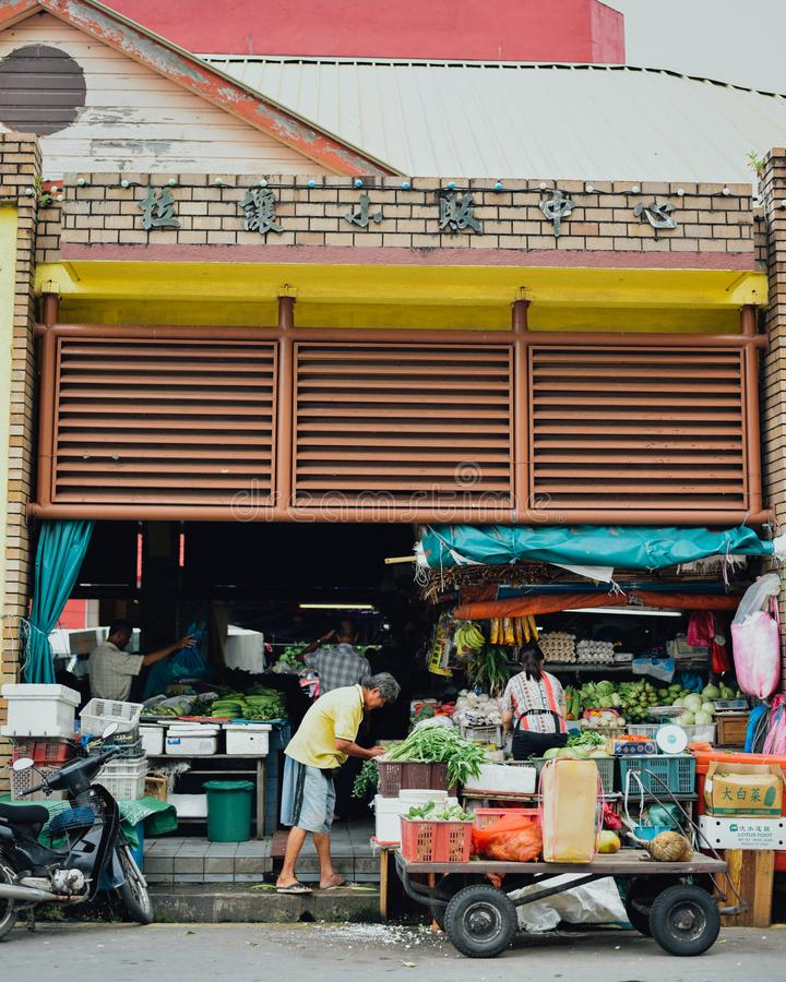 Market: Sellers at fresh markets selling vegetables royalty free stock photography