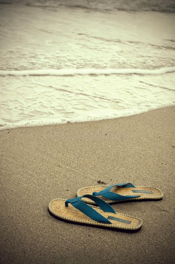 Vintage Looking Sepia Sandals and Ocean Water stock photo