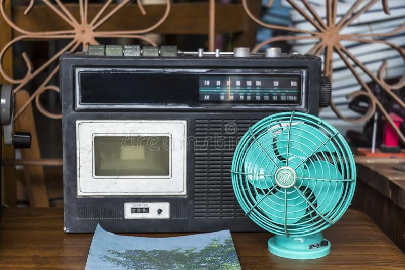 Vintage looking table fan and retro cassette player royalty free stock image