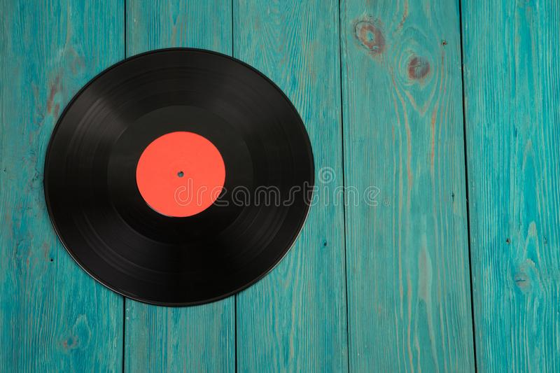 Vintage lp record on the wooden desk. Vintage record on the wooden desk stock photos