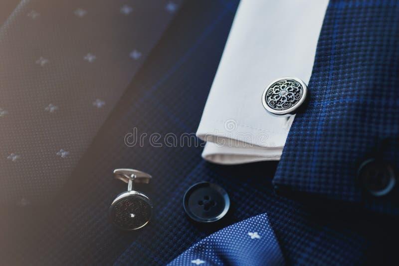 Luxury men`s cufflinks. Vintage luxury genteleman style background. Men`s cufflinks, accessories for tuxedo, butterfly, tie royalty free stock photo
