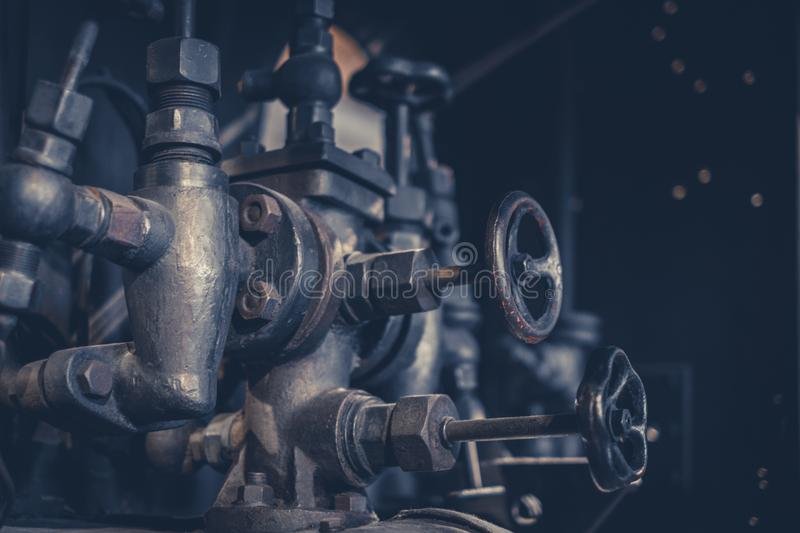 Vintage machinery, pipes and valves inside old factory royalty free stock photos
