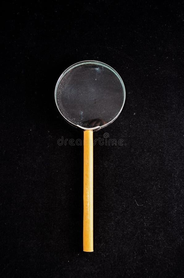 Vintage Magnify Glass Loupe. On a Black Background stock photo