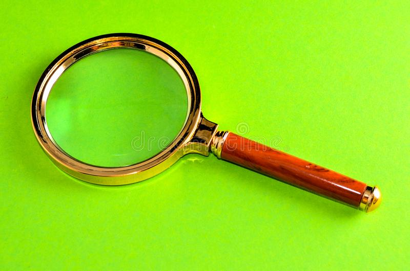 Vintage Magnify Glass Loupe. On a Colored Background royalty free stock photo