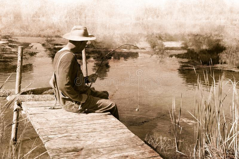 Vintage Man Fishing, Nostalgia, Fisherman. Vintage retro scene of a man fishing on an old wood pier. The fisherman is using a tree branch for a fishing pole stock image