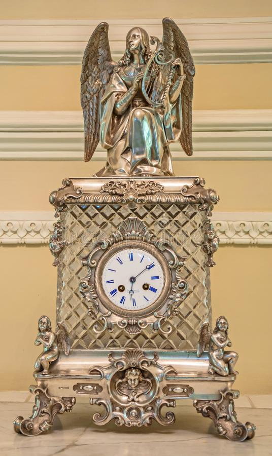 Vintage mantel clock. With the figure of an angel from the exhibition of the Faberge Museum. Saint Petersburg, Russia. January 2, 2019 royalty free stock photos