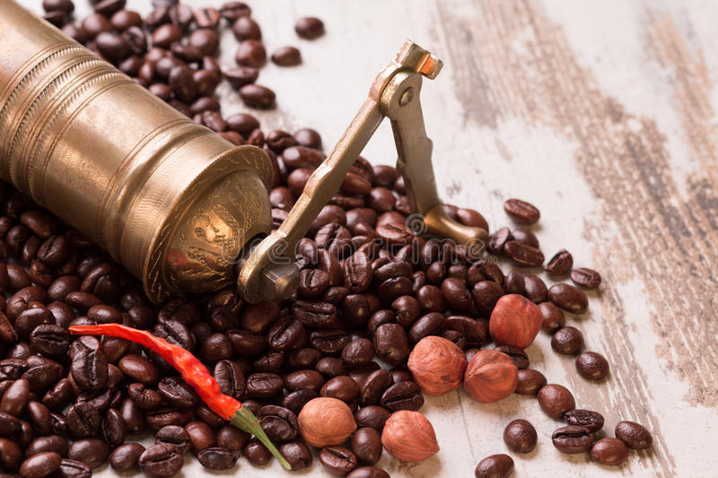 Vintage manual coffee grinder with coffee beans isolated stock photography