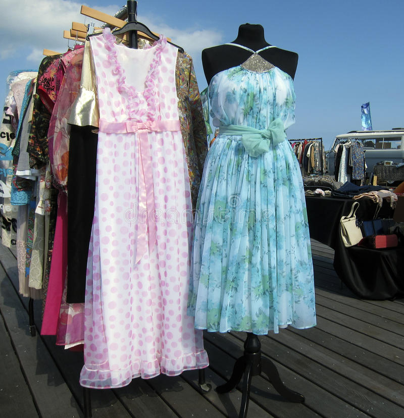 Vintage market. Outdoor vintage market - dresses for sale on the pier royalty free stock photos