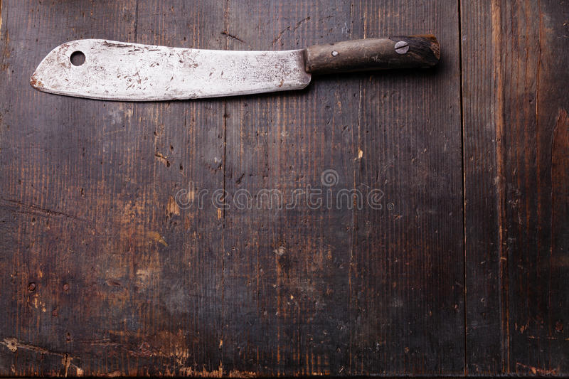 Vintage Meat cleaver. On dark wooden background royalty free stock photo