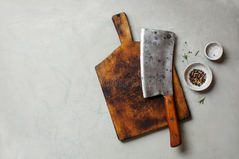 Vintage Meat cleaver. On a empty cutting Board. Top view, space for text stock photos