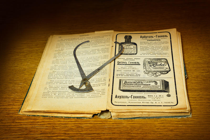 Vintage medical instrument and ancient tutorial royalty free stock photo