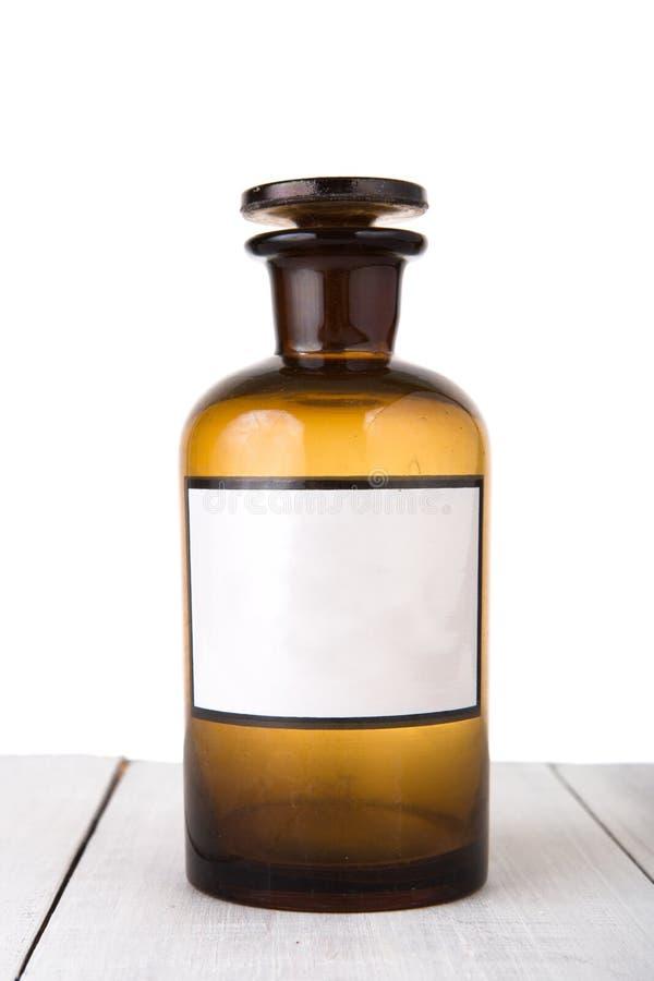 Vintage medicine bottle with blank label stock image