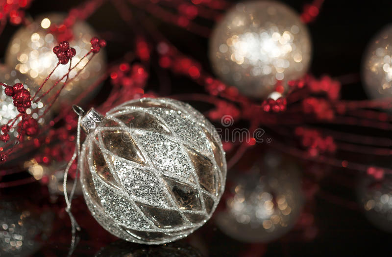 Vintage Mercury Silver Christmas Ornament. A silver vintage mercury glass Christmas ornament with diamond shaped pattern, black reflective surface, red and