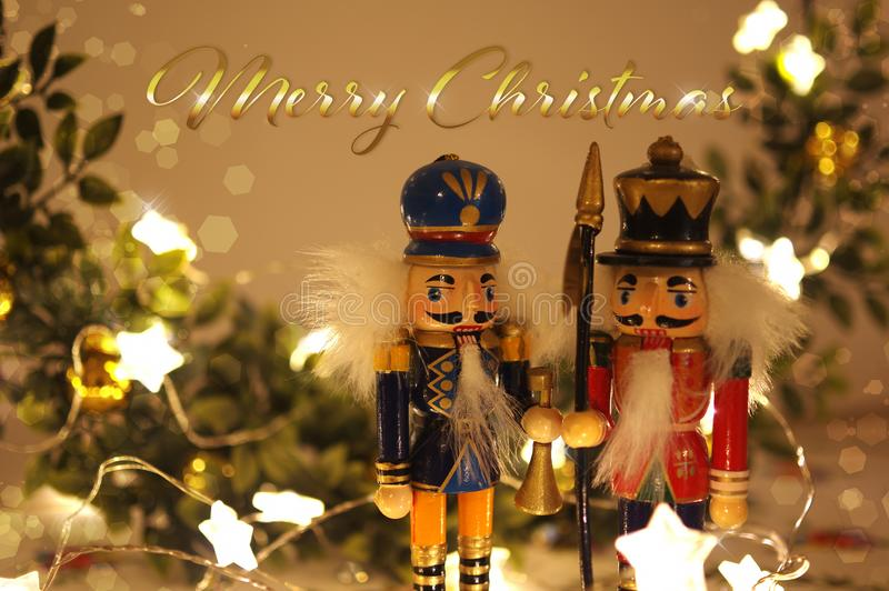 Vintage Merry Christmas greeting card with nutracker soldier toys and christmas lights royalty free stock images