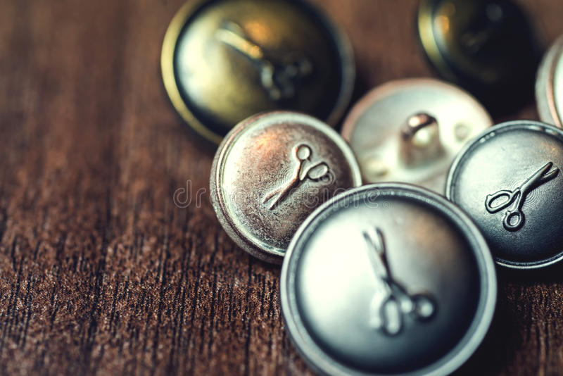 Vintage metal buttons with scissors on it stock photo