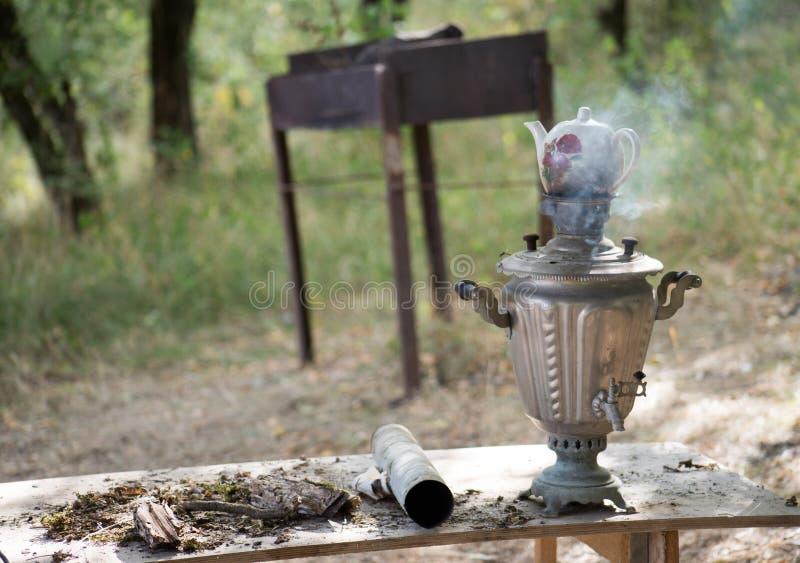 Vintage metal copper tea samovar. Samovar side view. Retro soot grunge tea samovar was used for a long time royalty free stock photography