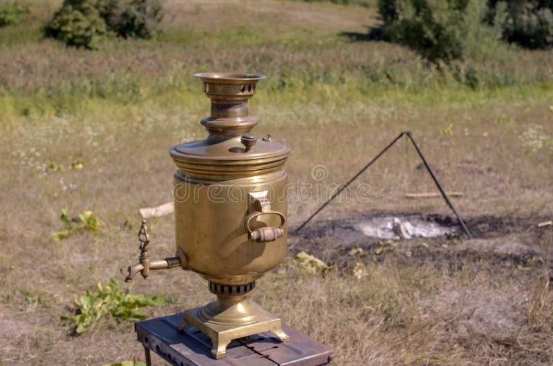 Vintage metal copper tea samovar. Samovar side view. Retro soot grunge tea samovar was used for a long time. Burned with stock image