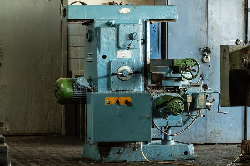 Vintage metal cutting lathe in factory interior royalty free stock photos