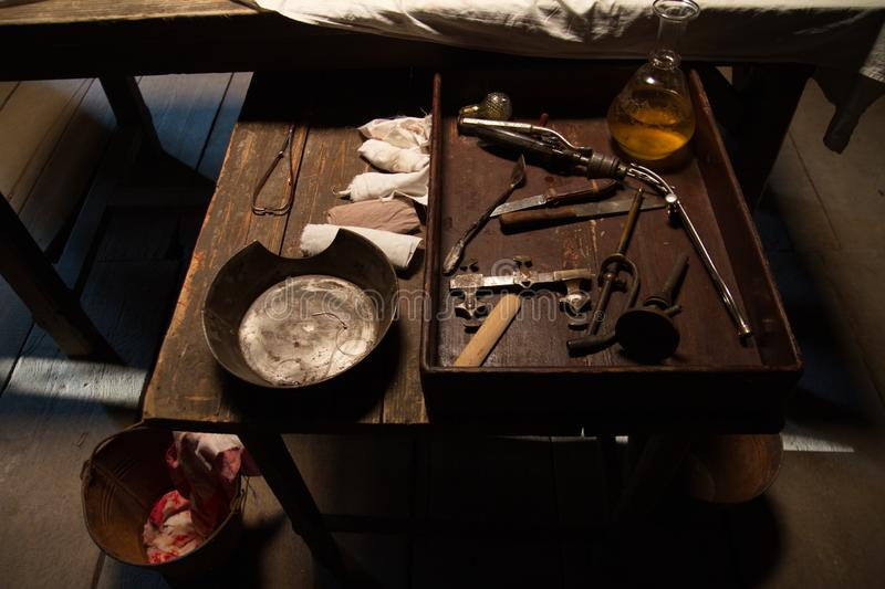 Vintage surgical instruments on wooden table royalty free stock photo