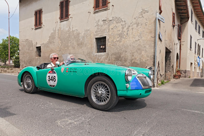 Vintage MG A Roadster in Mille Miglia 2014. The crew S. Dixon A. Harding on a vintage british car MG A Roadster (1955) in historical italian race Mille Miglia royalty free stock image