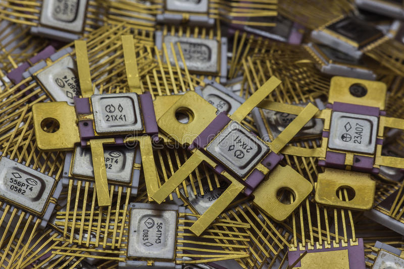 Vintage microchip, military electronics, goldplated stock photos