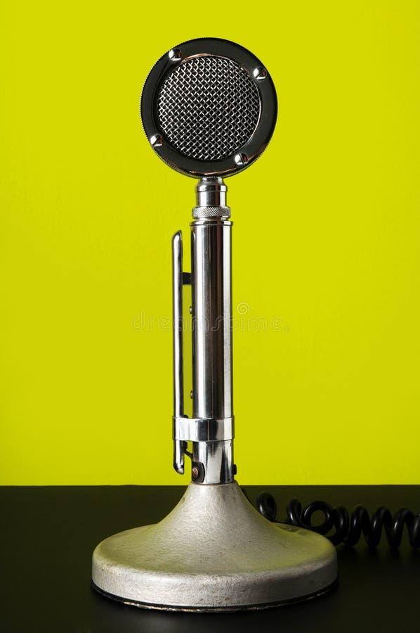 Vintage Microphone With Modern Headphones Stock Image