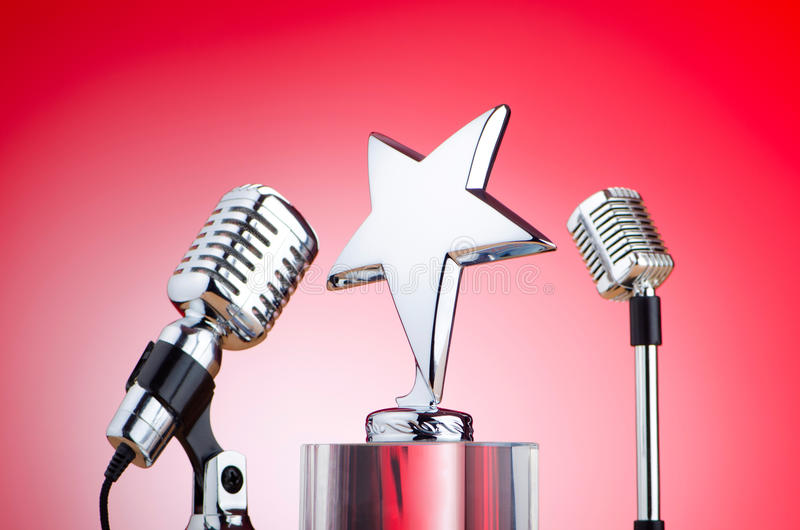 Vintage microphone against red background royalty free stock image