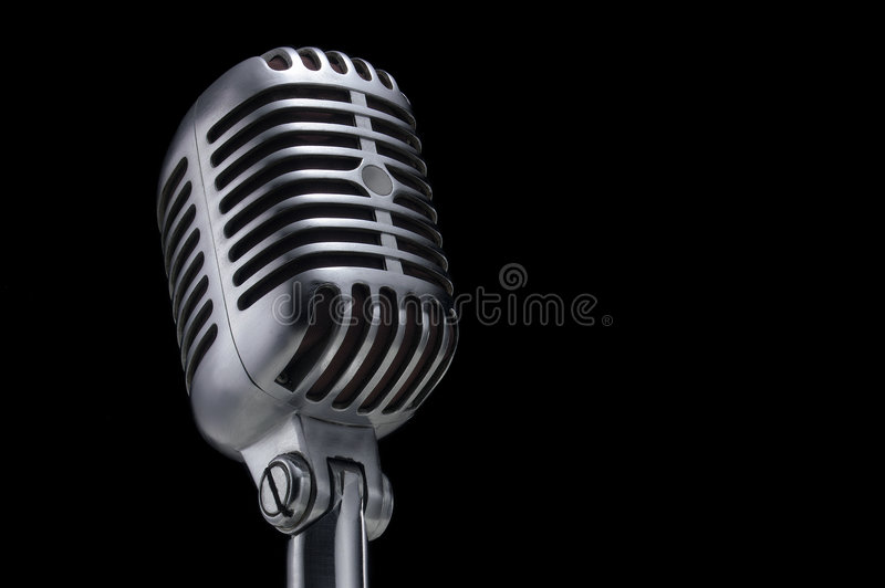 Vintage microphone on black stock photography