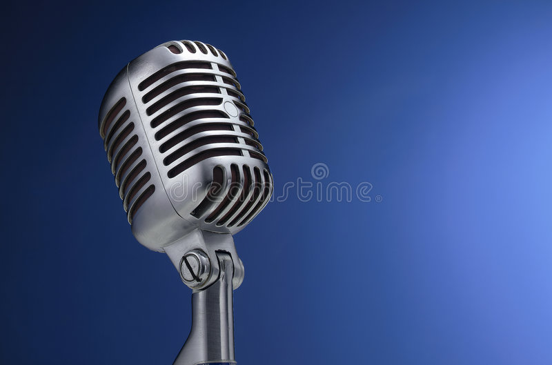 Vintage Microphone On Blue Royalty Free Stock Photos