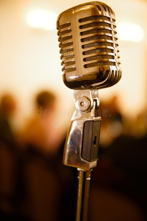 Vintage microphone on brown royalty free stock photo