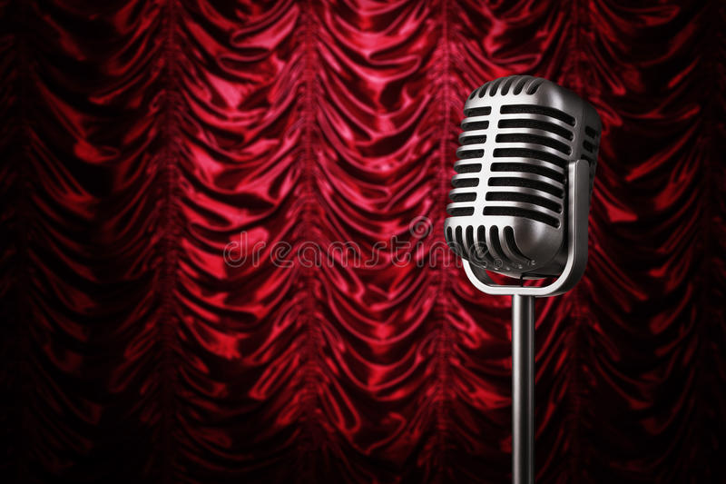 Vintage microphone. Close up of vintage silver microphone at the theater stage with copy space royalty free stock photography