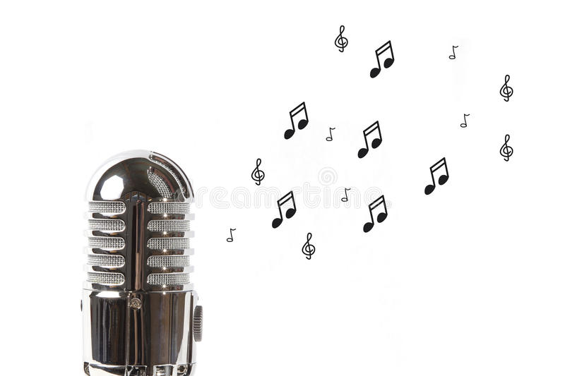 Vintage microphone with sheet music. On white background stock photo
