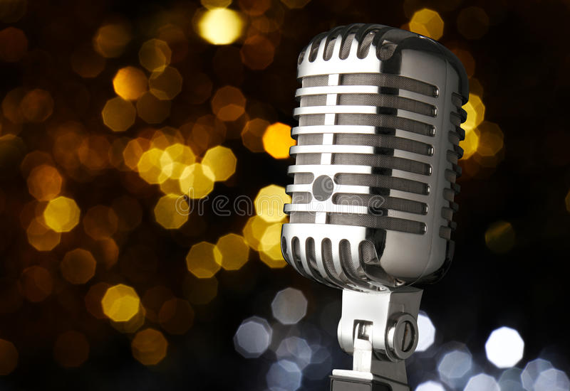Vintage microphone on stage. Vintage microphone of a popular artist with spot lights stock photography