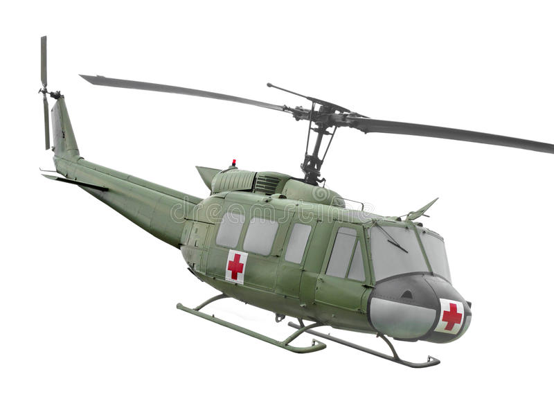 Vintage military helicopter isolated. Vintage green military ambulance helicopter. Isolated on white royalty free stock photo