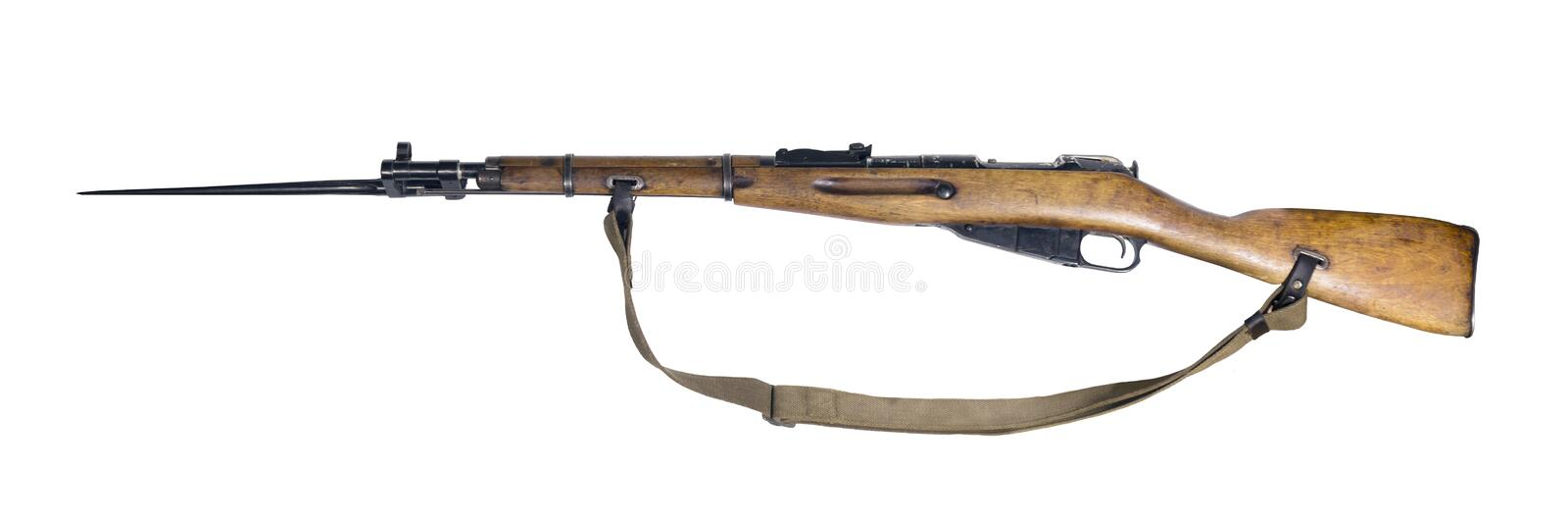 Vintage military rifle on white background. Vintage military rifle with bayonet in its open position, isolated royalty free stock photography